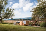 Relax in the wood-fired hot tub with views over the Herefordshire countryside