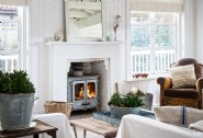 Warm by the woodburner after bracing winter coastal hikes