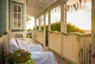 Enjoy the beach from the covered veranda whatever the weather