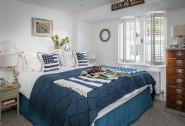 The bedrooms bedecked with fine linens and a stylish grown-up nautical motif