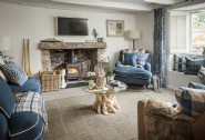 Enjoy cosy evenings curled up next to the wood burner at Beauport