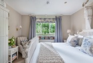 The ground floor master bedroom boasts romantic French inspired decor