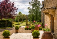 The gorgeous gardens and honey-hued stone walls of Burcombe House