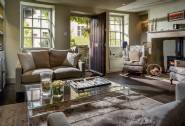 Relax in the luxurious living area of Burdock Fox in Castle Combe