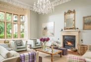 The drawing room at Butterfly House flaunts an open fire