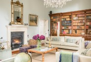 The drawing room boasts an original bookcase at this luxury self-catering home
