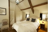 Double room with views out across the gardens to the rolling hills beyond