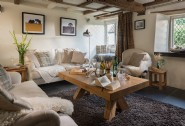 A quaint self-catering thatched cottage with traditional exposed beams