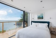 The stylish, light-filled bedroom at Delphin