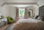 The master bedroom is on the second floor and accessed via a private staircase