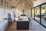 Slide-open doors create the perfect inside-outside space in the modern kitchen