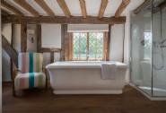 Spacious en suite bathroom with luxurious freestanding bathtub