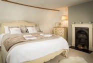 The luxurious master bedroom with a king-size bed