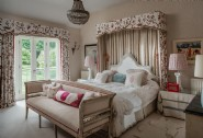 Floral touches are peppered throughout the romantic master bedroom