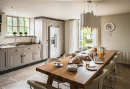 The spacious kitchen with large informal dining table