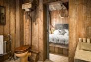 En suite bathroom with custom-built concrete bath and sink