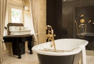 Recline in the clawfoot bathtub... glass of bubbly optional