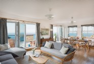 The light-filled living room at Galleon with uninterrupted sea views