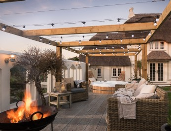 Hot tub set with the walled garden of this luxury Cornish cottage