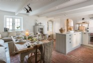 Gather in the french style kitchen with terracotta stone floors
