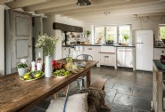 The open plan kitchen-dining area with farmhouse table