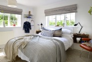 The bedroom adorned with luxury linens
