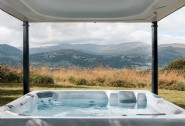 Savour mountain views from Hinterland´s bubbling hot tub