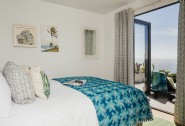 The double bedroom is a sea dream, with king-size bed set and French windows