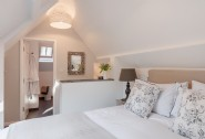 Light filled king-size bedroom with en suite