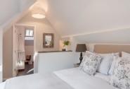 Light filled king-size bedroom with en suite