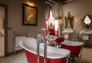The opulent bathroom complete with two slipper baths