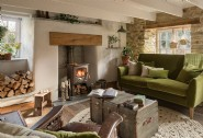 Relax by the crackling fire in the cosy living area
