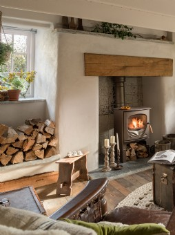 Little Portion Cottage sitting room with log burner, Holywell Bay