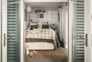 The cosy double bedroom with French doors onto the deck