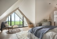 The en suite master bedroom boasts extensive sea views