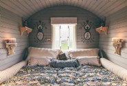 The bedroom wagon features a super king-size bed overlooking the country