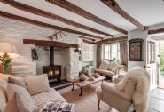 The cosy sitting room with log fire