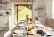 Family suppers in the open plan kitchen-dining room