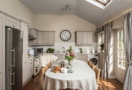 The bright and airy open plan kitchen dining room is fully equipped