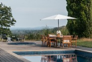 Relax in Rhapsody´s outdoor swimming pool and hot tub