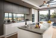 The open-plan kitchen dining area is on the first floor and boasts sea views