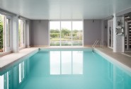 Relax in the heated indoor swimming pool