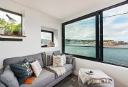 The first floor living area makes the most of the water views