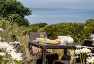 Take in the sea views whilst al fresco dining at Seapink Cottage