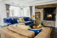 The cosy living room with log fire