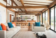 The large, open-plan living room and kitchen overlooks the estuary