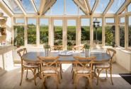 The bright and airy dining area makes the most of the countryside views