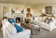 Cosy up beside the fire in the living area with waterfront views