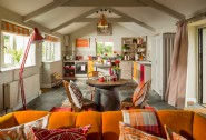Open plan living area sprinkled with upcyled family hierlooms