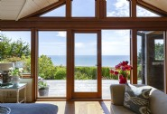 Floor-to-ceiling windows looking out at the sea